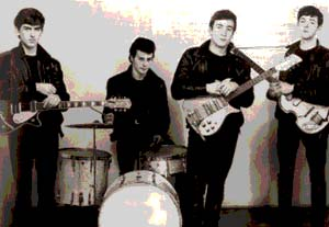 The early days of The Beatles, when they were still wearing the leather gear that made them stand out during the time they spent playing in Hamburg, Germany. This is among the first of the publicity photos ever taken of The Beatles and Pete Best (second left) was still the drummer for the band.
