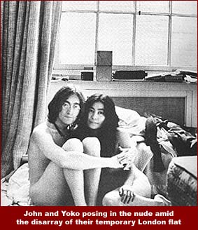 Another photo of John and Yoko from the Two Virgins era: here they pose nude amid the disarray of their temporary London flat that was sub-leased to them by John's bandmate, Ringo Starr.
