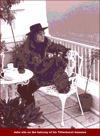 John Lennon sits on the balcony of his Tittenhurst mansion outside of London, England. John Lennon lived here with Yoko Ono in the early 1970s and when he and Yoko moved to New York City, he sold the property to fellow Beatle, Ringo Starr.