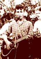 John Lennon playing with The Quarrymen. This was John first real band and for a time, it was the nucleus of The Beatles, once Paul McCartney and George Harrison joined the group.