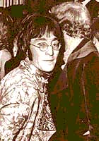 John Lennon at a gala opening with his friend Pete Shotton
