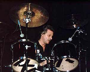 Pete Best plays drums at a fan convention in the 1990s