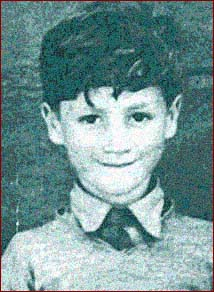 John Lennon as a young boy, while he was growing up in Liverpool, England in the 1940s.